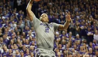 Kansas State  guard Marcus Foster (2)  dunks against Texas during the second half of an NCAA college basketball game Saturday, Feb. 8, 2014, in Manhattan, Kan. (AP Photo/The Wichita Eagle, Bo Rader) LOCAL TV OUT; MAGS OUT; LOCAL RADIO OUT; LOCAL INTERNET OUT