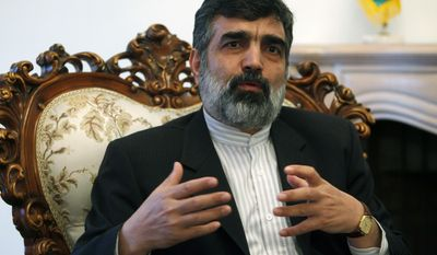 FILE - In this file photo taken Saturday, March 12, 2011, Iran's Deputy Foreign Minister Behrouz Kamalvandi speaks during a press conference in La Paz, Bolivia. Kamalvandi is on a two-day visit to Bolivia. As the IAEA team arrived in Tehran on Friday, Feb. 7, 2014, the state IRNA news agency cited Iranian atomic energy organization spokesman Kamalvandi as saying his country is ready to answer all questions raised by the U.N. agency. (AP Photo/Juan Karita, File)