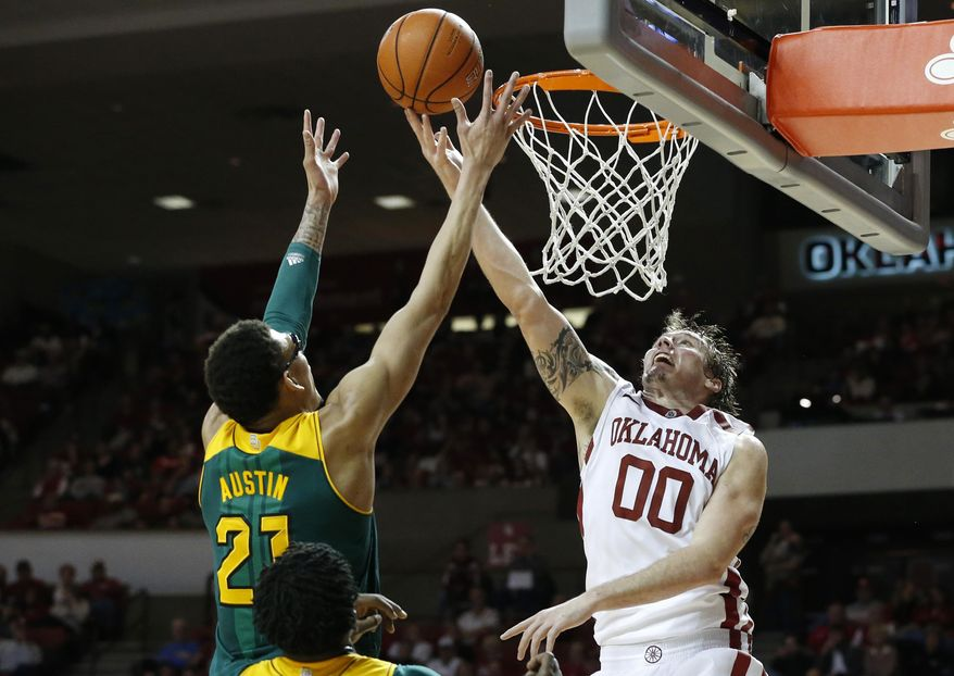 Oklahoma forward Ryan Spangler (00) and Baylor center Isaiah Austin (21) reach for a rebound in the second half of an NCAA college basketball game in Norman, Okla., Saturday, Feb. 8, 2014. Oklahoma won 88-72. (AP Photo/Sue Ogrocki)