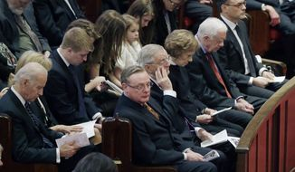 Vice President Joe Biden, left, joins former Vice President Walter Mondale and his family for the memorial service for Joan Mondale, at Westminster Presbyterian Church, Saturday, Feb. 8, 2014 in Minneapolis. Seated with Mondale, second from left, is son Ted, left, former first lady Rosalynn Carter, former President Jimmy Carter and Mondale son William, right. Joan Mondale, 83,  died Feb. 3. (AP Photo/Jim Mone)