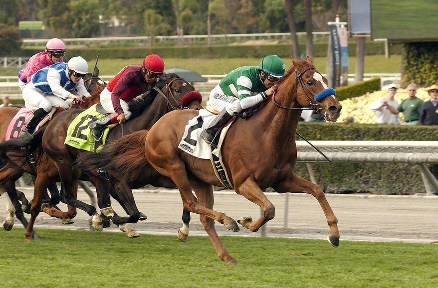 ** FILE ** Irish-bred Vagabond Shoes, right, with Victor Espinoza aboard, wins the Grade II San Marcos Stakes horse race on Saturday, Feb. 8, 2014, at Santa Anita Park in Arcadia, Calif. (AP Photo/Benoit Photo)