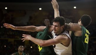 From front left to right, Oregon guard Jason Calliste, Arizona State center Jordan Bachynski and Oregon center Waverly Austin become entangled during an NCAA college basketball game on Saturday, Feb. 8, 2014, in Tempe, Ariz. (AP Photo/The Arizona Republic, Stacie Scott) MARICOPA COUNTY OUT; NO SALES