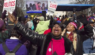 "Kathy Jones reacts during the closing remarks by Rev. William Barber at the ""Moral March on Raleigh"" on Fayetteville Street in Raleigh, N.C.,  on Saturday, Feb. 8, 2014.  Nearly 200 organizations are joining the National Association for the Advancement of Colored People in the ""Moral March on Raleigh,"" a new name for the ""Historic Thousands on Jones Street,"" as it was originally called. Jones Street referred to the street where the Legislative Building stands and the usual terminus of the march. (AP Photo/The News & Observer, Robert Willett)"
