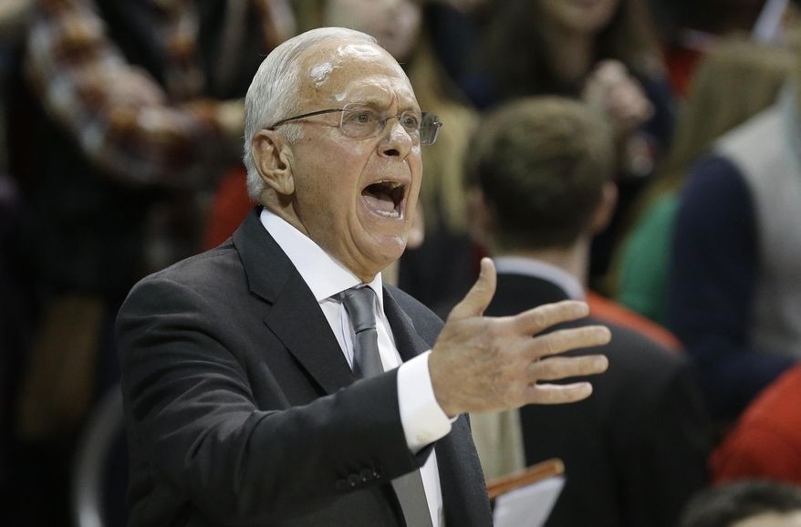 SMU coach Larry Brown yells from the sideline during the first half of an NCAA college basketball game against Cincinnati on Saturday, Feb. 8, 2014, in Dallas. (AP Photo/LM Otero)  vcb