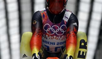 Felix Loch of Germany brakes after finishing his second run during the men's singles luge competition at the 2014 Winter Olympics, Saturday, Feb. 8, 2014, in Krasnaya Polyana, Russia. (AP Photo/Dita Alangkara)