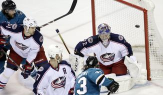 San Jose Sharks' John McCarthy, bottom right, scores past Columbus Blue Jackets goalie Sergei Bobrovsky, top right, during the first period of an NHL hockey game, Friday, Feb. 7, 2014, in San Jose, Calif. (AP Photo/Marcio Jose Sanchez)