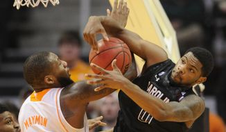 Tennessee forward Jeronne Maymon (34) and South Carolina guard Sindarius Thornwell (0) tangle for a rebound during the second half of an NCAA college basketball game Saturday, Feb. 8, 2014, in Knoxville, Tenn. Tennessee won 72-53. (AP Photo/Knoxville News Sentinel, Adam Lau)