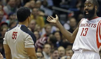 Houston Rockets' James Harden (13) argues a call by referee Bill Kennedy (55) during the first half of an NBA basketball game Saturday, Feb. 8, 2014, in Milwaukee. (AP Photo/Jeffrey Phelps)