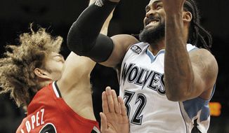 Minnesota Timberwolves center Ronny Turiaf (32) grabs a rebound from Portland Trail Blazers center Robin Lopez in the first quarter of their NBA basketball game on Saturday, Feb. 8, 2014 in Minneapolis.(AP Photo/Andy Clayton-King)