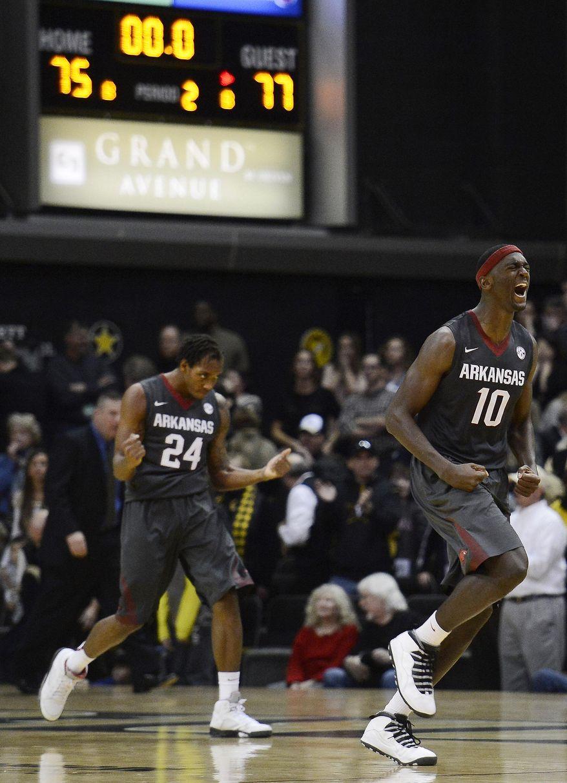 Arkansas guard Michael Qualls (24) and forward Bobby Portis (10) celebrate after Arkansas defeated Vanderbilt 77-75 in an NCAA college basketball game on Saturday, Feb. 8, 2014, in Nashville, Tenn.  (AP Photo/Mark Zaleski)