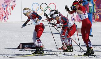 Norway's Therese Johaug, Norway's Marit Bjoergen and Poland's Justyna Kowalczyk, from left, start the women's 15k skiathlon at the 2014 Winter Olympics, Saturday, Feb. 8, 2014, in Krasnaya Polyana, Russia. (AP Photo/Dmitry Lovetsky)