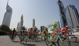 Cyclists start the final stage of the Dubai Tour in Dubai, United Arab Emirates, Saturday, Feb. 8, 2014. (AP Photo/Kamran Jebreili)