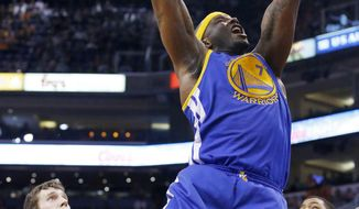 Golden State Warriors' Jermaine O'Neal (7) dunks as Phoenix Suns' Goran Dragic, left, of Slovenia, and Markieff Morris, right, stand near during the first half of an NBA basketball game Saturday, Feb. 8, 2014, in Phoenix. (AP Photo/Ross D. Franklin)