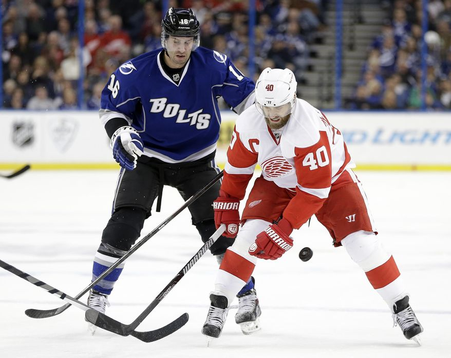 Detroit Red Wings left wing Henrik Zetterberg (40) loses the puck as he attempts to get around Tampa Bay Lightning right wing Teddy Purcell (16) during the first period of an NHL hockey game Saturday, Feb. 8, 2014, in Tampa, Fla. (AP Photo/Chris O'Meara)
