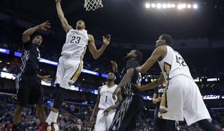New Orleans Pelicans power forward Anthony Davis (23) goes to the basket in the first half of an NBA basketball game against the Minnesota Timberwolves in New Orleans, Friday, Feb. 7, 2014. (AP Photo/Gerald Herbert)