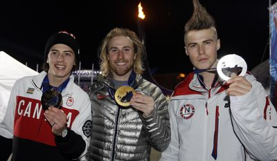 Men's snowboard slopestyle bronze medalist Mark McMorris, left, of Canada, silver medalist Staale Sandbech, right, of Norway and gold medalist Sage Kotsenburg of the United States hold up their medals at the 2014 Winter Olympics, Saturday, Feb. 8, 2014, in Sochi, Russia. (AP Photo/Morry Gash, Pool)