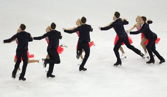 In this multiple exposure photo, Ekaterina Bobrova and Dmitri Soloviev of Russia compete in the team ice dance short dance figure skating competition at the Iceberg Skating Palace during the 2014 Winter Olympics, Saturday, Feb. 8, 2014, in Sochi, Russia. (AP Photo/Bernat Armangue)