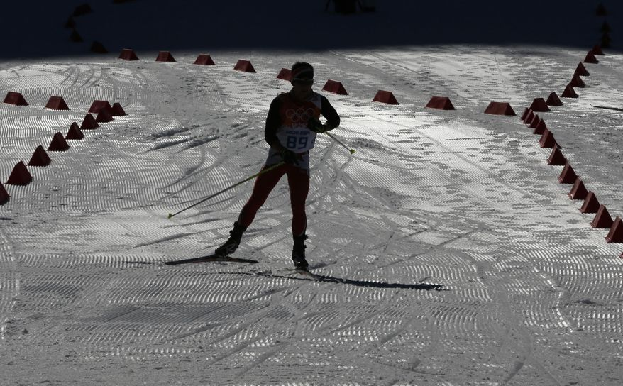 A Nordic combined athlete trains at the ski jumping venue prior to the 2014 Winter Olympics, Thursday, Feb. 6, 2014, in Krasnaya Polyana, Russia. (AP Photo/Matthias Schrader)
