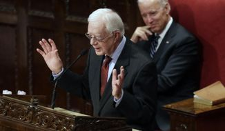 ** FILE ** Former President Jimmy Carter pays tribute to Joan Mondale at her memorial service at Westminster Presbyterian Church, Saturday, Feb. 8, 2014 in Minneapolis. Joan Mondale, 83, died Feb. 3. At right is Vice President Joe Biden who also spoke. (AP Photo/Jim Mone)