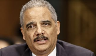 ** FILE ** In this Jan. 29, 2014, file photo, Attorney General Eric Holder testifies on Capitol Hill in Washington. (AP Photo/J. Scott Applewhite, File)