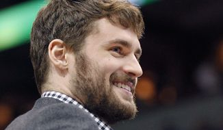 Minnesota Timberwolves forward Kevin Love smiles as he did not play in the game against the Portland Trail Blazers on Saturday, February 8, 2014 in Minneapolis.(AP Photo/Andy Clayton-King)