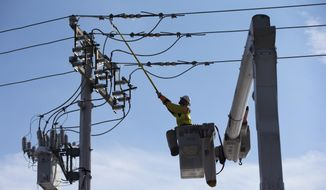 A linesman works to restore electrical power, Friday, Feb. 7, 2014, in Downingtown, Pa. A small army of electricity restoration crews labored Friday to reconnect about 330,000 customers in Pennsylvania and Maryland.  (AP Photo/Matt Rourke)