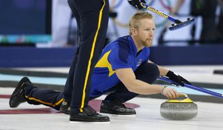 Sweden skip Niklas Edin delivers the stone during men's curling training at the 2014 Winter Olympics, Saturday, Feb. 8, 2014, in Sochi, Russia. (AP Photo/Robert F. Bukaty)