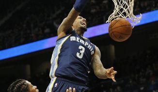 Memphis Grizzlies forward James Johnson (3) dunks as Atlanta Hawks forward Cartier Martin (20) defends during the second half of an NBA basketball game Saturday, Feb. 8, 2014, in Atlanta.  Memphis won 79-76. (AP Photo/John Bazemore)