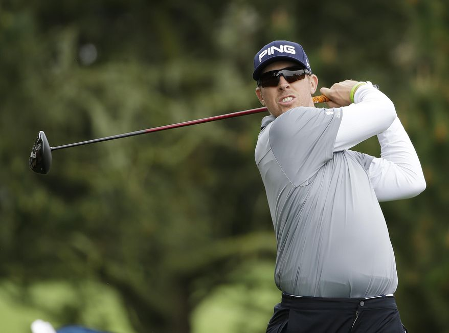 Hunter Mahan follows his drive from the second tee during the final round of the AT&T Pebble Beach Pro-Am golf tournament, Sunday, Feb. 9, 2014, in Pebble Beach, Calif. (AP Photo/Eric Risberg)