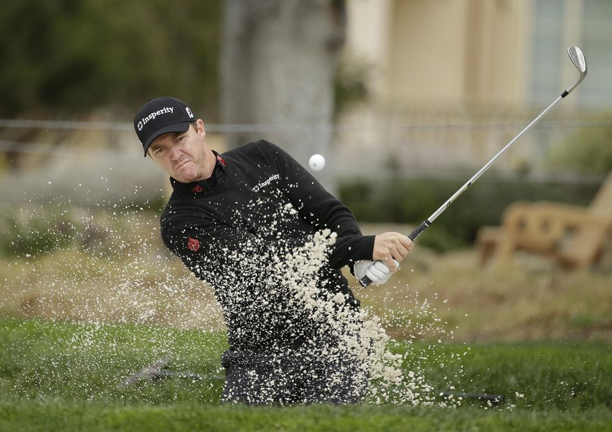 Jimmy Walker hits out of a bunker onto the second green during the final round of the AT&T Pebble Beach Pro-Am golf tournament, Sunday, Feb. 9, 2014, in Pebble Beach, Calif. (AP Photo/Eric Risberg)
