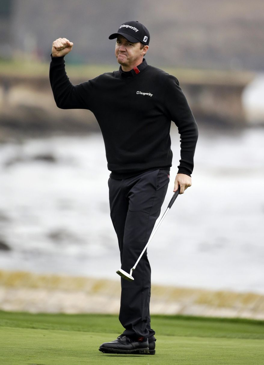 Jimmy Walker celebrates on the 18th green Sunday, Feb. 9, 2014, after winning the AT&T Pebble Beach Pro-Am golf tournament in Pebble Beach, Calif. (AP Photo/Eric Risberg)