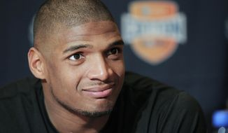 FILE - In this Jan. 1, 2014, file photo, Missouri senior defensive lineman Michael Sam speaks to the media during an NCAA college football news conference in Irving, Texas. Sam says he is gay, and he could become the first openly homosexual player in the NFL. (AP Photo/Brandon Wade, File)