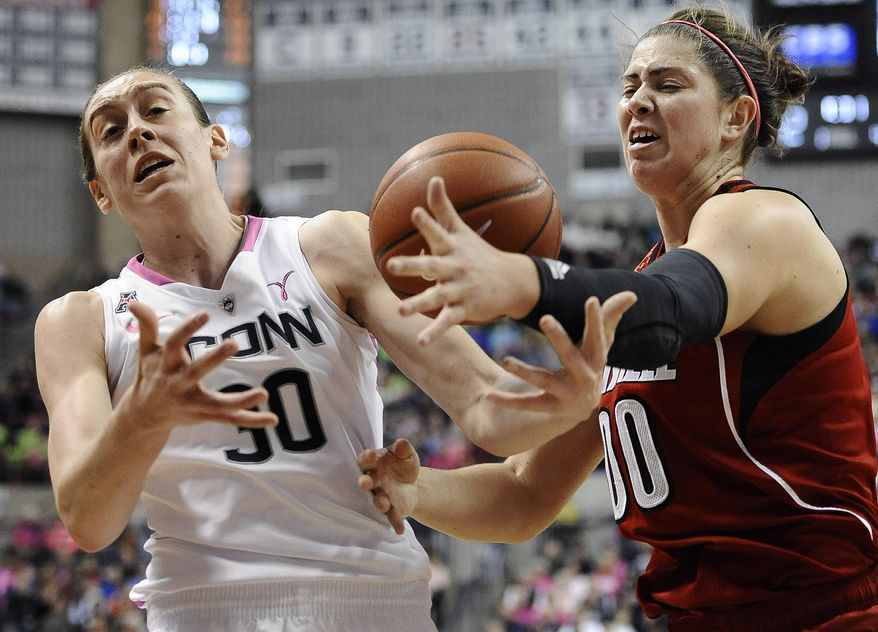 Connecticut's Breanna Stewart, left, and Louisville's Sara Hammond, right, reach for a loose ball during the first half of an NCAA college basketball game on Sunday, Feb. 9, 2014, in Storrs, Conn. (AP Photo/Jessica Hill)