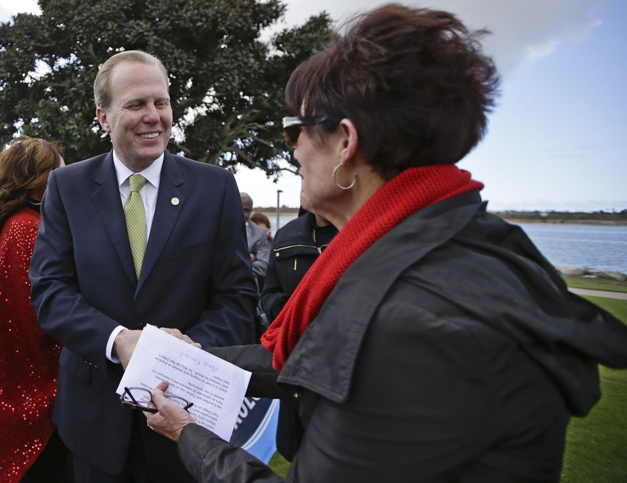 In a Monday, Feb. 3, 2014 photo, San Diego mayoral candidate Kevin Faulconer does a bit of handshaking during a campaign event, in San Diego. Faulconer easily topped a field of 11 candidates in a first round of voting by dominating in wealthier neighborhoods north of the freeway. (AP Photo/Lenny Ignelzi)