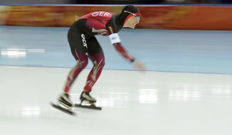 Claudia Pechstein of Germany grimaces as she competes in the women's 3,000-meter speedskating race at the Adler Arena Skating Center during the 2014 Winter Olympics, Sunday, Feb. 9, 2014, in Sochi, Russia. (AP Photo/Patrick Semansky)
