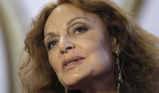 Designer Diane von Furstenberg speaks to reporters backstage before showing her Fall 2014 collection during Fashion Week in New York, Sunday, Feb. 9, 2014. (AP Photo/Seth Wenig)