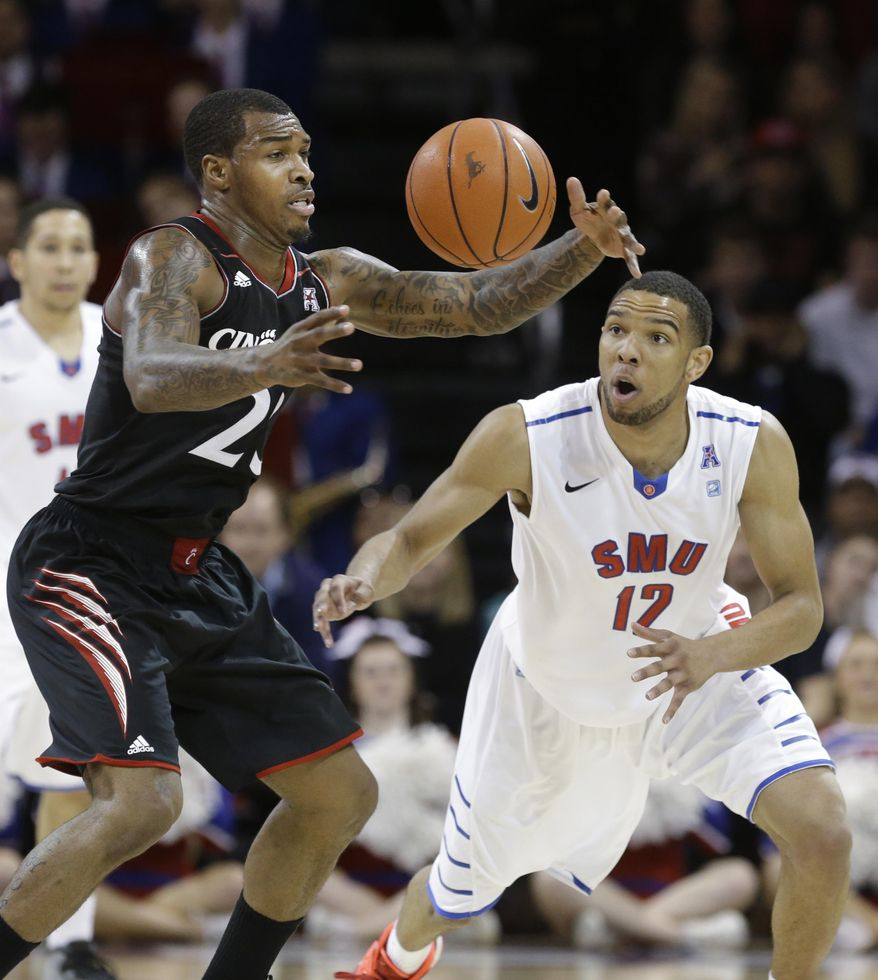Cincinnati guard Sean Kilpatrick (23) loses control of the ball against SMU guard Nick Russell (12) during the second half of an NCAA college basketball game Saturday, Feb. 8, 2014, in Dallas. SMU won 76-55. (AP Photo/LM Otero)