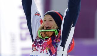 Britain's Jenny Jones celebrates after winning the bronze medal in the the women's snowboard slopestyle final at the 2014 Winter Olympics, Sunday, Feb. 9, 2014, in Krasnaya Polyana, Russia.  (AP Photo/Andy Wong)