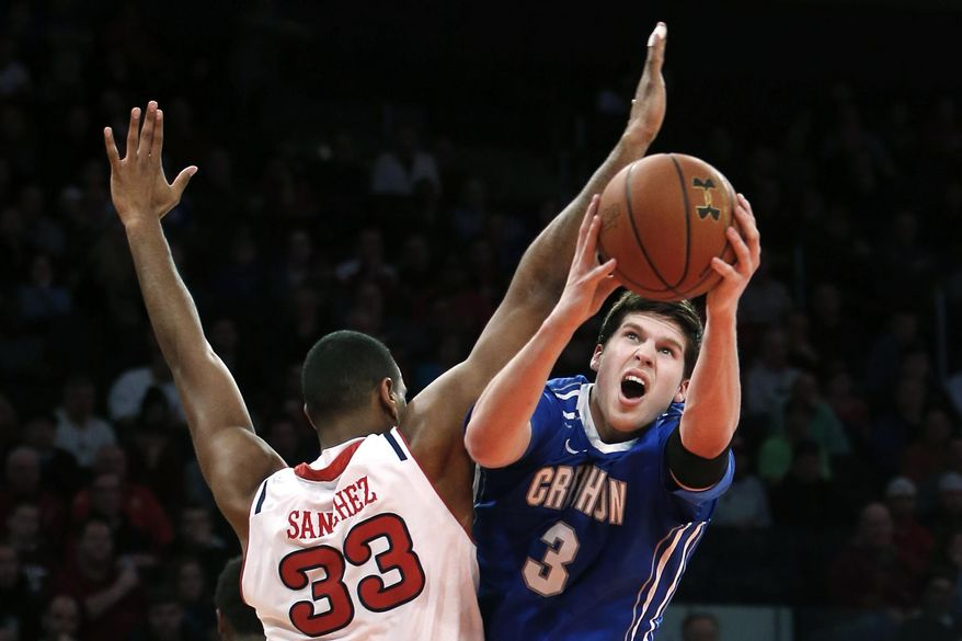 Creighton's Doug McDermott (3) shoots against St. John's Orlando Sanchez (33), of the Dominican Republic, during the first half of an NCAA college basketball game, Sunday, Feb. 9, 2014, in New York. (AP Photo/Jason DeCrow)
