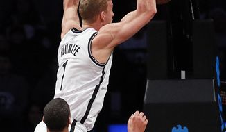 Brooklyn Nets forward Mason Plumlee (1) stuffs a basket in the first half of an NBA basketball game against the New Orleans Pelicans on Sunday, Feb. 9, 2014, in New York. (AP Photo/Paul J. Bereswill)