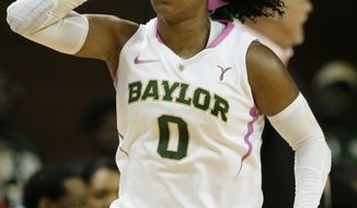 Baylor guard Odyssey Sims (0) celebrates after scoring a three-pointer against Oklahoma State in the first half of an NCAA women's college basketball games, Sunday, Feb. 9, 2014, in Waco, Texas. Both teams in the contest are wearing uniforms accenting in pink helping bring attention to breast cancer awareness. (AP Photo/Tony Gutierrez)