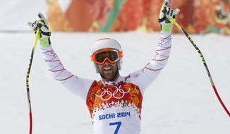 United States' Travis Ganong gestures after finishing the men's downhill at the Sochi 2014 Winter Olympics, Sunday, Feb. 9, 2014, in Krasnaya Polyana, Russia. (AP Photo/Christophe Ena)