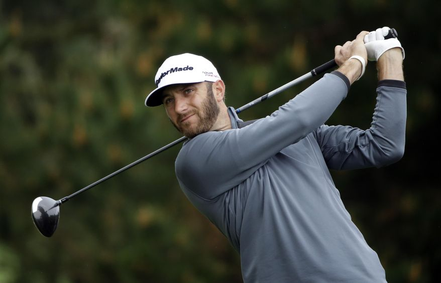 Dustin Johnson hits off the second tee on Sunday, Feb. 9, 2014, during the final round of the AT&T Pebble Beach Pro-Am golf tournament in Pebble Beach, Calif. (AP Photo/Ben Margot)