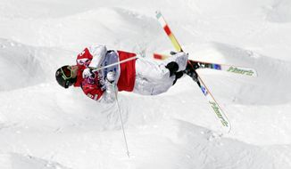 Canada's Alex Bilodeau jumps during freestyle skiing moguls training at the Rosa Khutor Extreme Park ahead of the 2014 Winter Olympics, Friday, Feb. 7, 2014, in Krasnaya Polyana, Russia. (AP Photo/Andy Wong)