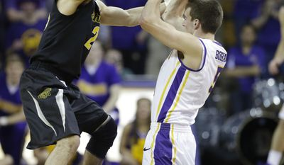 Wichita State guard Fred VanVleet, left, tries to steal the ball from Northern Iowa guard Matt Bohannon during the first half of an NCAA college basketball game on Saturday, Feb. 8, 2014, in Cedar Falls, Iowa. (AP Photo/Charlie Neibergall)