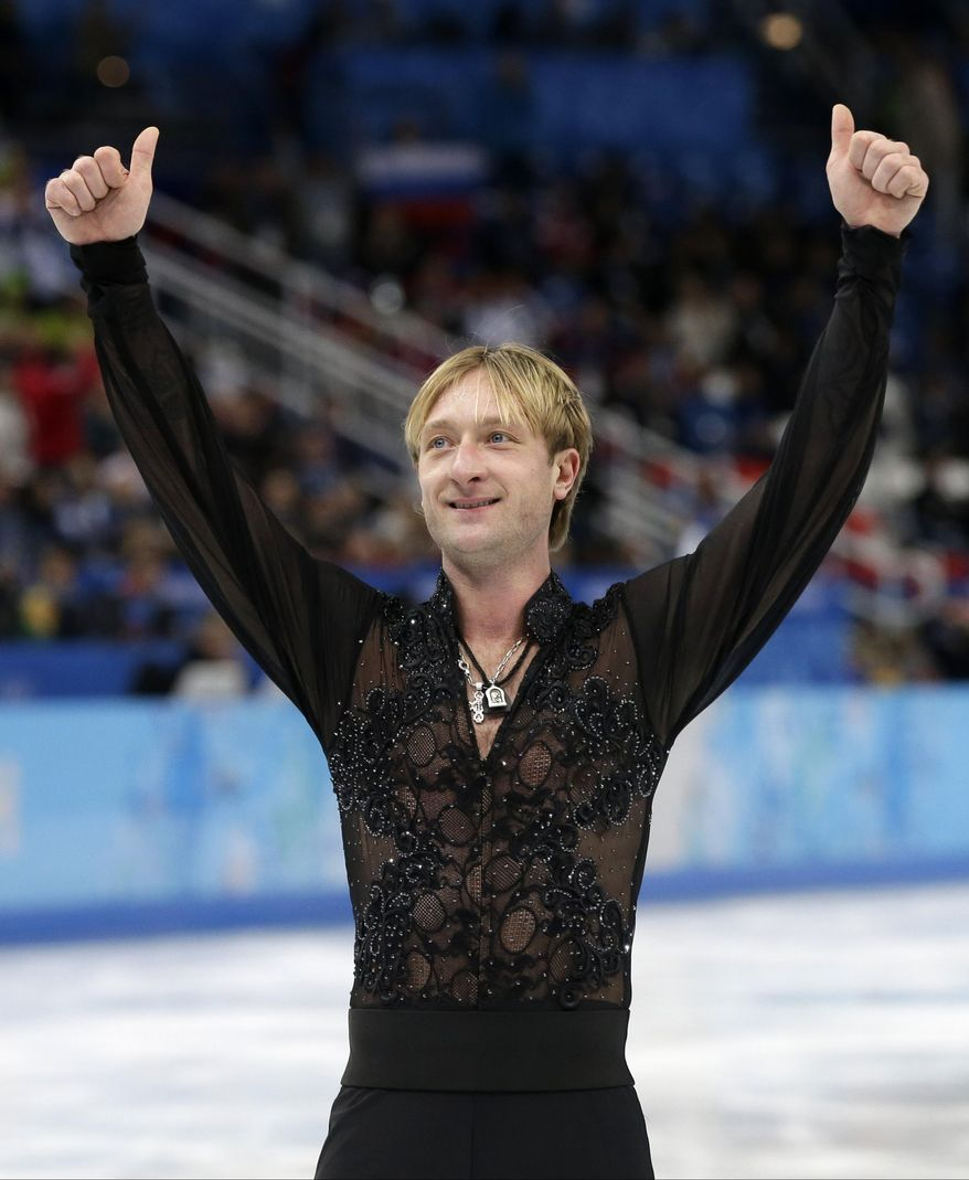 Evgeni Plushenko of Russia gestures to spectators as he leaves the ice after competing in the men's team free skate figure skating competition at the Iceberg Skating Palace during the 2014 Winter Olympics, Sunday, Feb. 9, 2014, in Sochi, Russia. (AP Photo/Darron Cummings, Pool)