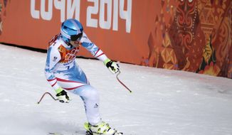 Austria's Matthias Mayer finishes to win the gold in the men's downhill at the Sochi 2014 Winter Olympics, Sunday, Feb. 9, 2014, in Krasnaya Polyana, Russia. (AP Photo/Gero Breloer)