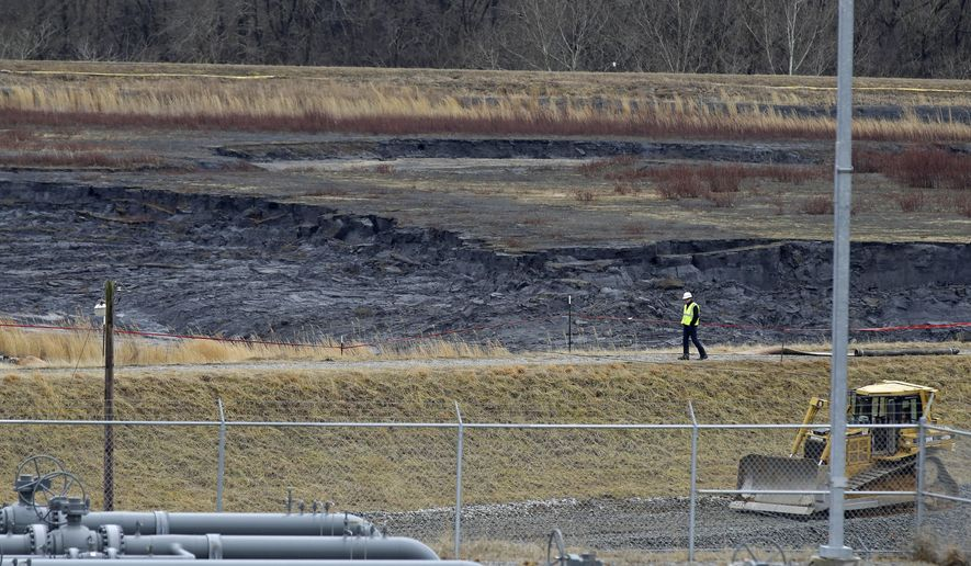 In this Wednesday, Feb. 5, 2014 photo, shows a coal ash pond at the Dan River Power Plant in Eden, N.C. Duke Energy estimates that up to 82,000 tons of ash from the pond has been released from a break in a 48-inch storm water pipe into the Dan River. (AP Photo/Gerry Broome)