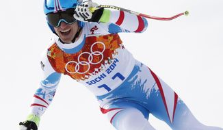 Austria's Matthias Mayer finishes the men's downhill at the Sochi 2014 Winter Olympics, Sunday, Feb. 9, 2014, in Krasnaya Polyana, Russia. (AP Photo/Christophe Ena)