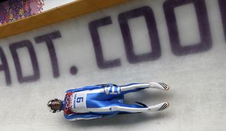 Armin Zoeggeler of Italy takes a turn on his final run during the men's singles luge final at the 2014 Winter Olympics, Sunday, Feb. 9, 2014, in Krasnaya Polyana, Russia. Zoeggeler won the bronze. (AP Photo/Dita Alangkara)